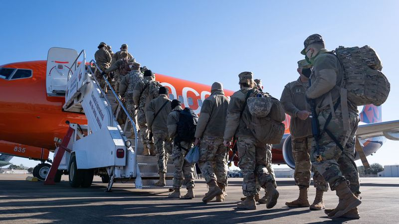 Troops with the Louisiana National Guard head to the U.S. Capitol.
