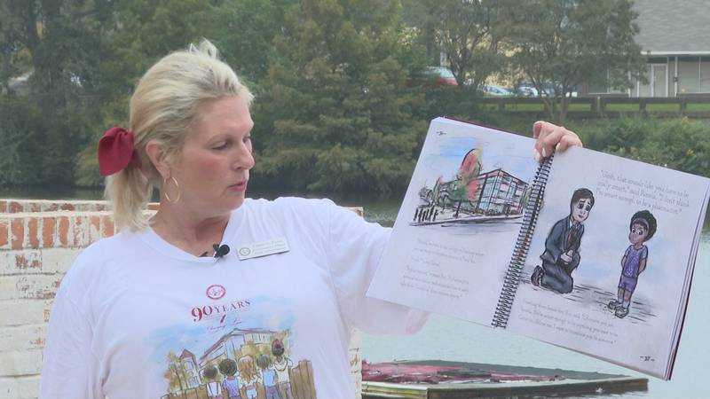 Author Cindy Foust reads her book based on ULM President Ronald Berry's life.