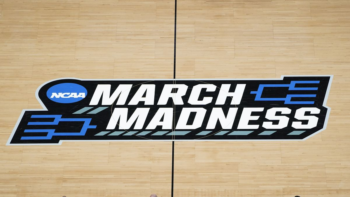 The March Madness logo is shown on the court during the first half of a men's college...