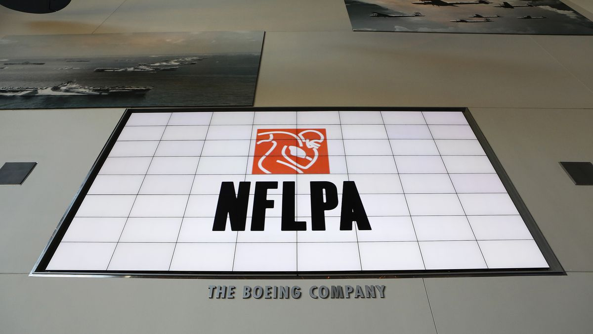 A general view of the NFLPA logo is seen on a video board during the NFLPA Legends Brunch at the National World War II Memorial Museum on Sunday February 3, 2013 in New Orleans, Louisiana.