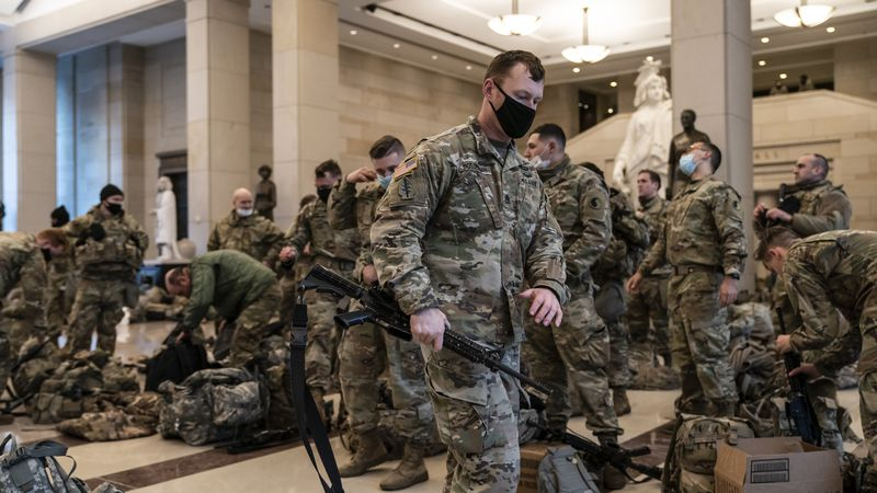 Hundreds of National Guard troops hold inside the Capitol Visitor's Center to reinforce...
