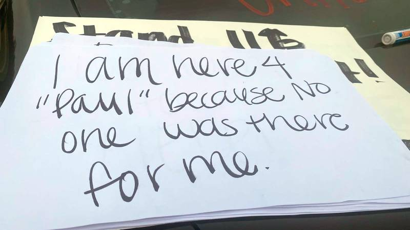 Several people held a rally to support a former student at the center of a lawsuit targeting...