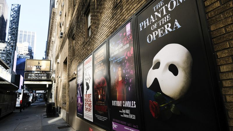FILE - Broadway posters hang outside the Richard Rodgers Theatre during Covid-19 lockdown in...