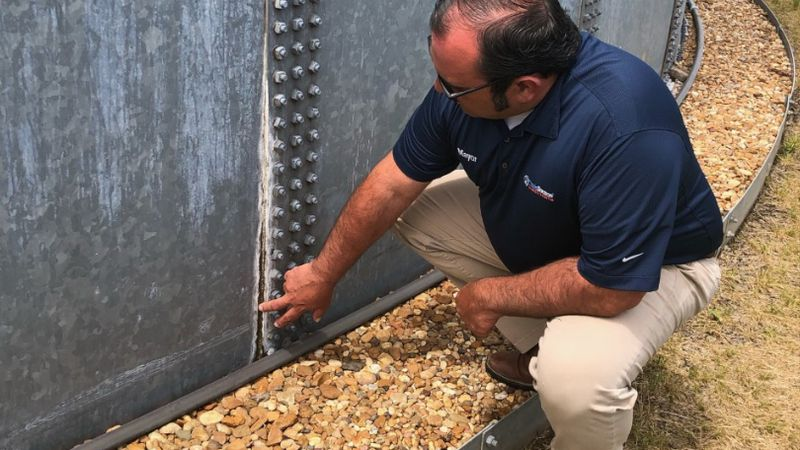 binary commOak Grove Mayor Adam Holland inspects recent leaks in the 500,000-gallon ground...