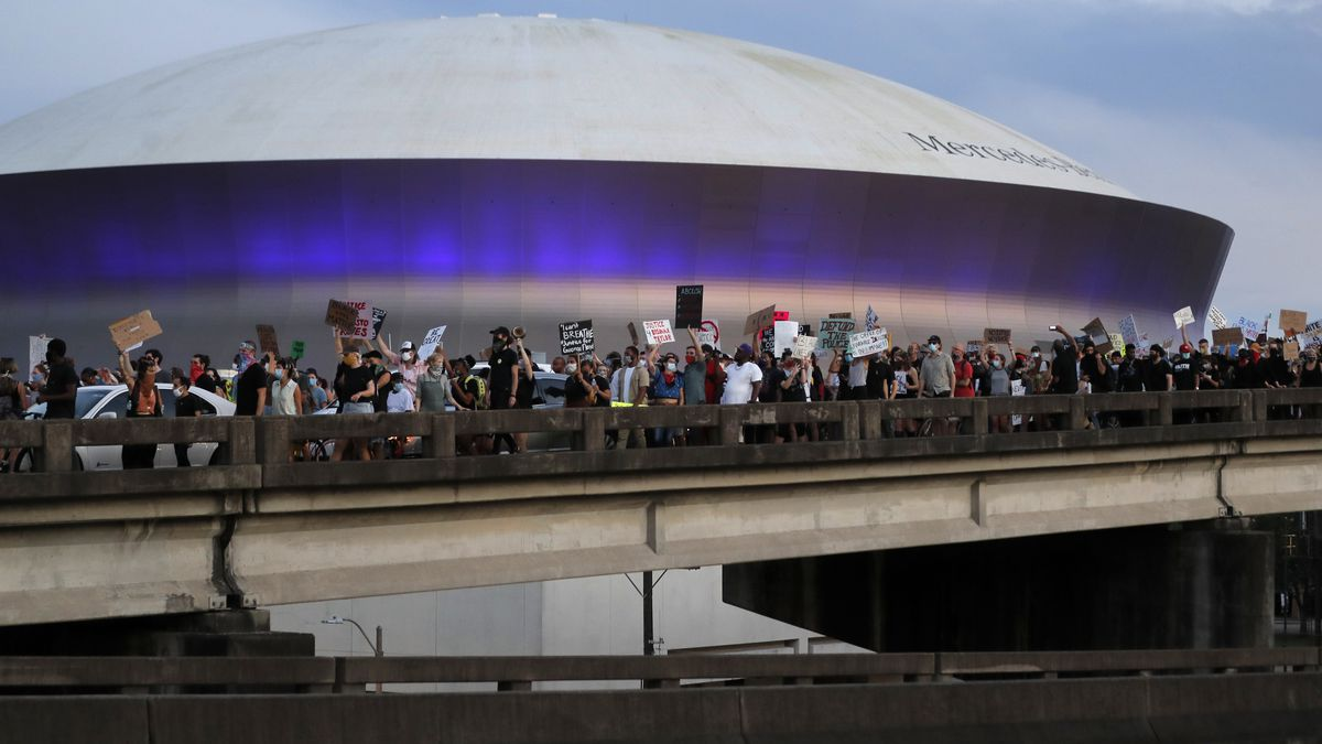 Protesters take over the elevated Interstate 10 during a march in New Orleans, Tuesday, June 2,...