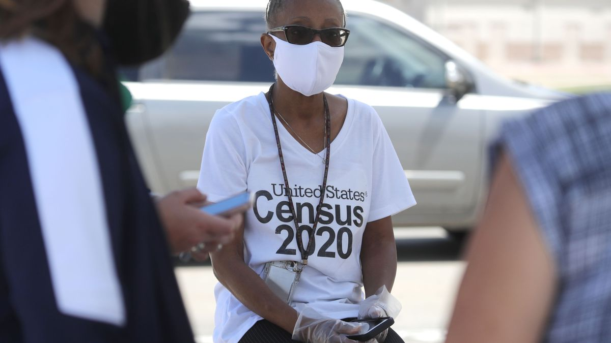 Amid concerns of the spread of COVID-19, census worker Jennifer Pope wears a mask and sits by ready to help at a U.S. Census walk-up counting site set up for Hunt County in Greenville, Texas, Friday, July 31, 2020.
