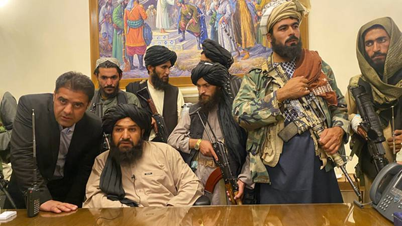 Taliban fighters take control of Afghan presidential palace after the Afghan President Ashraf...