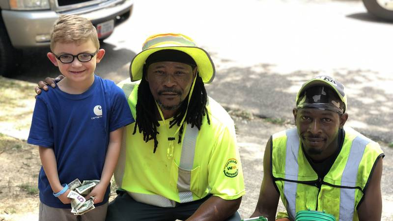 5-year-old Kutter Fisher of Hooks, TX, left, has a passion for trash trucks. After learning his...