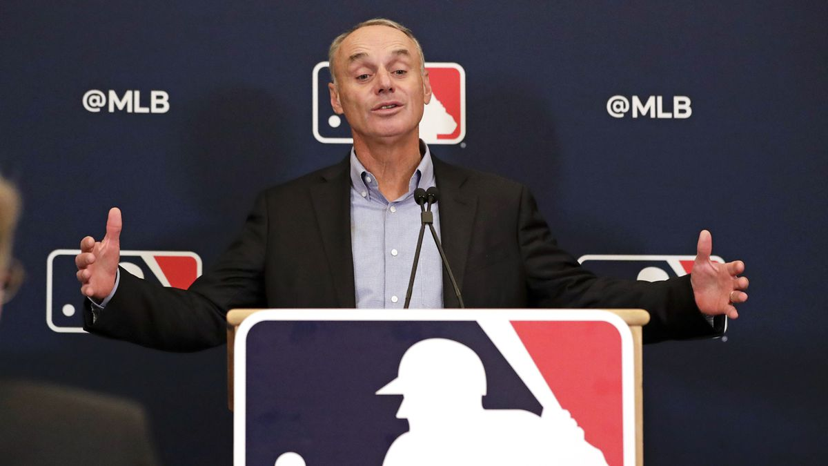 MLB Commissioner Rob Manfred answers questions at a press conference during MLB baseball owners meetings, Thursday, Feb. 6, 2020, in Orlando, Fla.