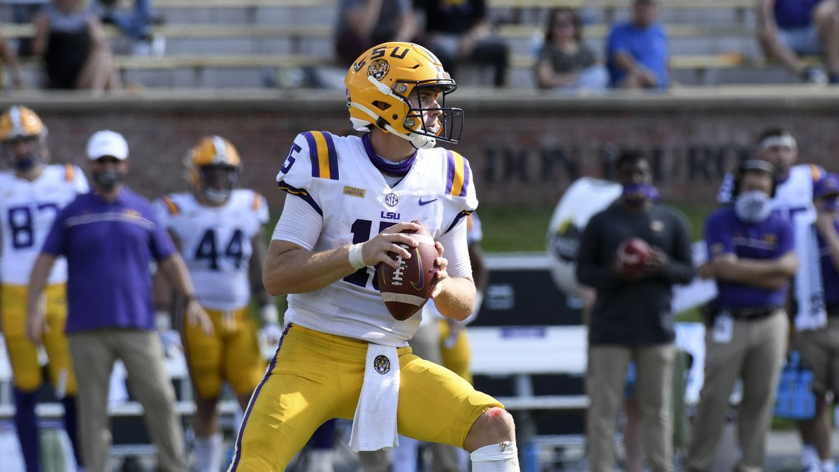 LSU quarterback Myles Brennan looks to pass during the second half of an NCAA college football...