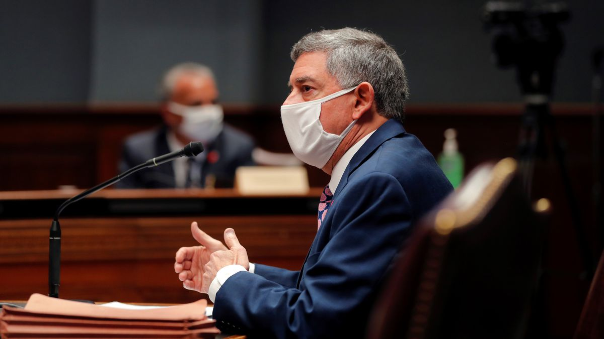 State commissioner of administration Jay Dardenne wears a mask as he testifies before the...