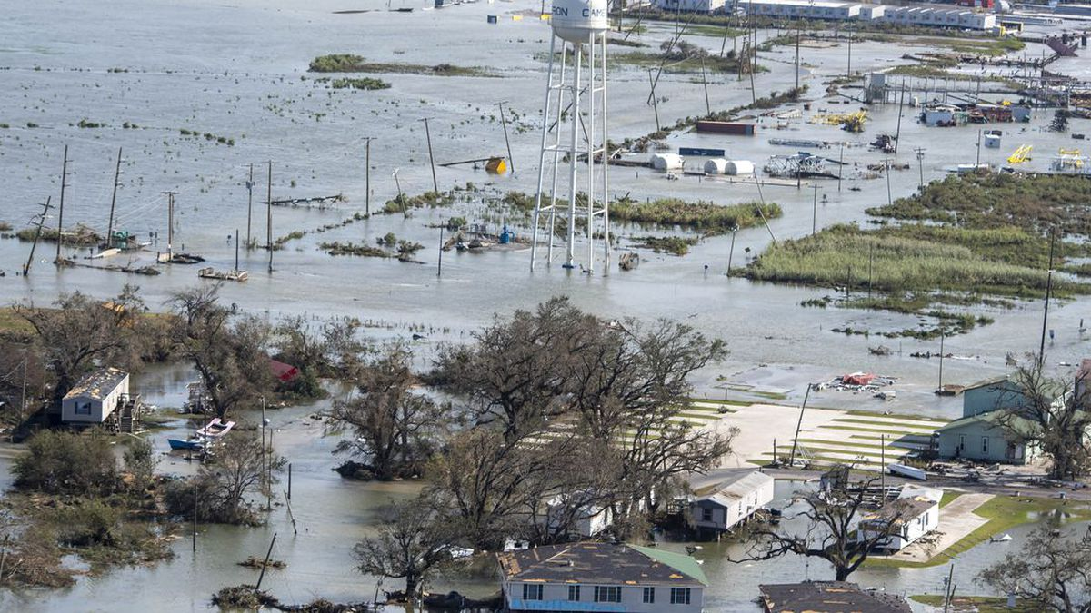FILE: Water covers land after the passage of Hurricane Laura, Thursday, Aug. 27, 2020, in...