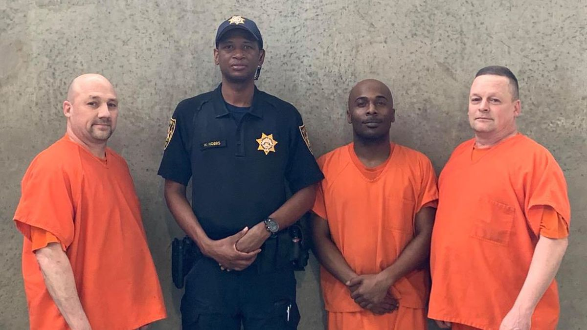 The three men were praised in late July for alerting officials at the Gwinnett County jail when a deputy became unconscious and fell.