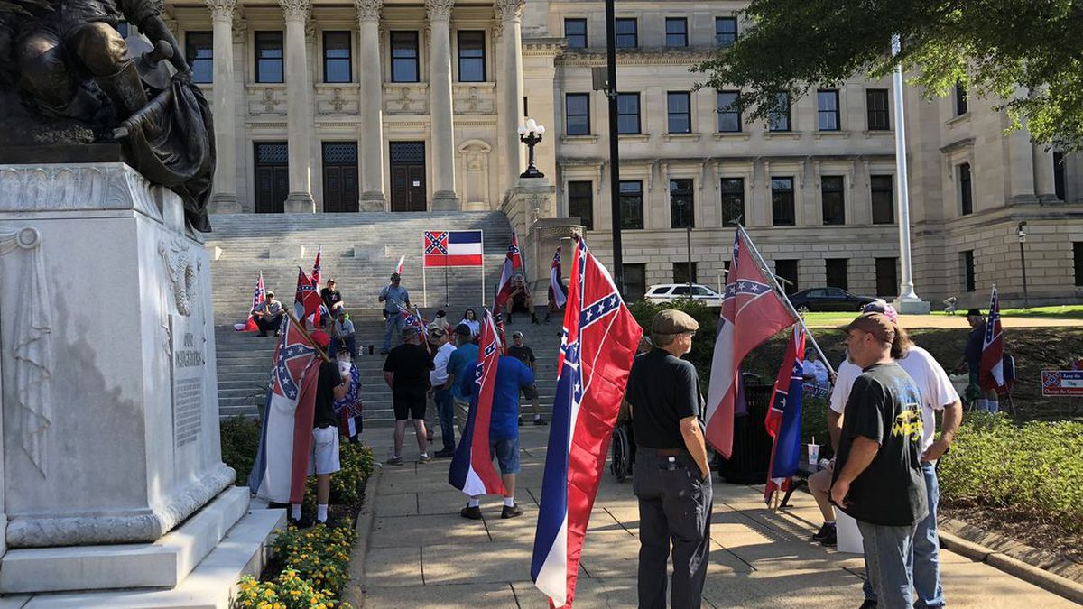 Rally underway calling for voters to decide what happens with the retired state flag.