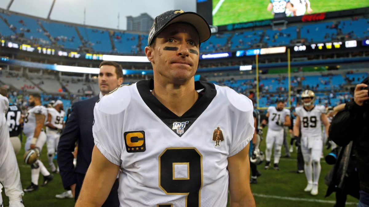 New Orleans Saints quarterback Drew Brees (9) leaves the field following an NFL football game...