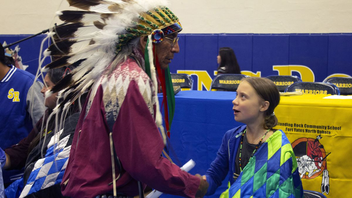 Chief Arvol Looking Horse greets Swedish climate activist Greta Thunberg. A federal judge has ordered the Dakota Access pipeline to shut down, pending an environmental review.