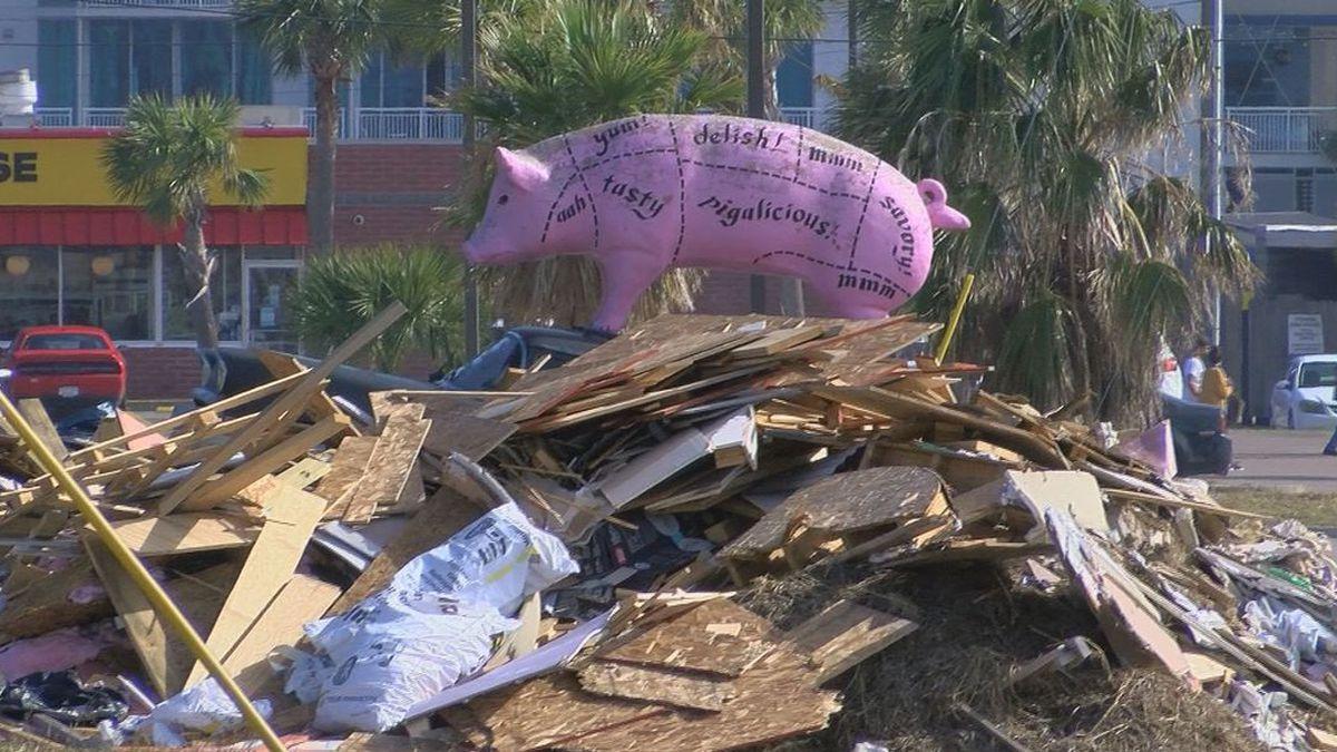 A visual trick puts the pig at Slap Ya Mamas BBQ in Biloxi on top of debris that still sits in...