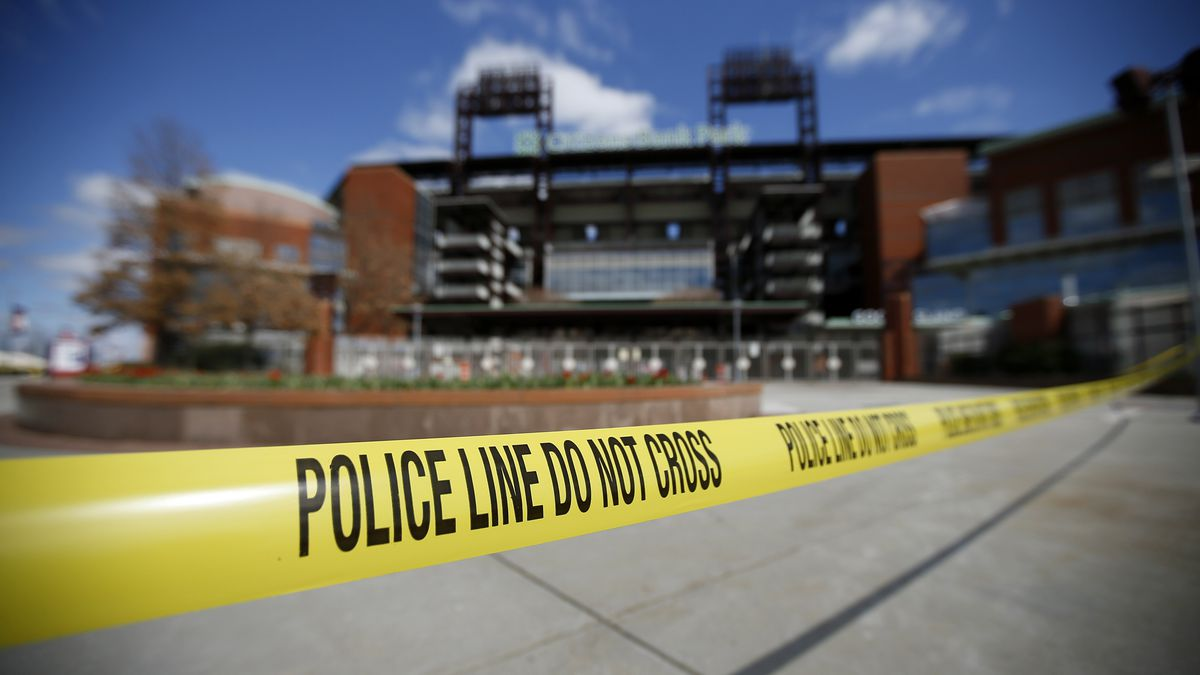 Police tape blocks an entrance to Citizens Bank Park, home of the Philadelphia Phillies baseball team, Tuesday, March 24, 2020, in Philadelphia. (AP Photo/Matt Slocum)