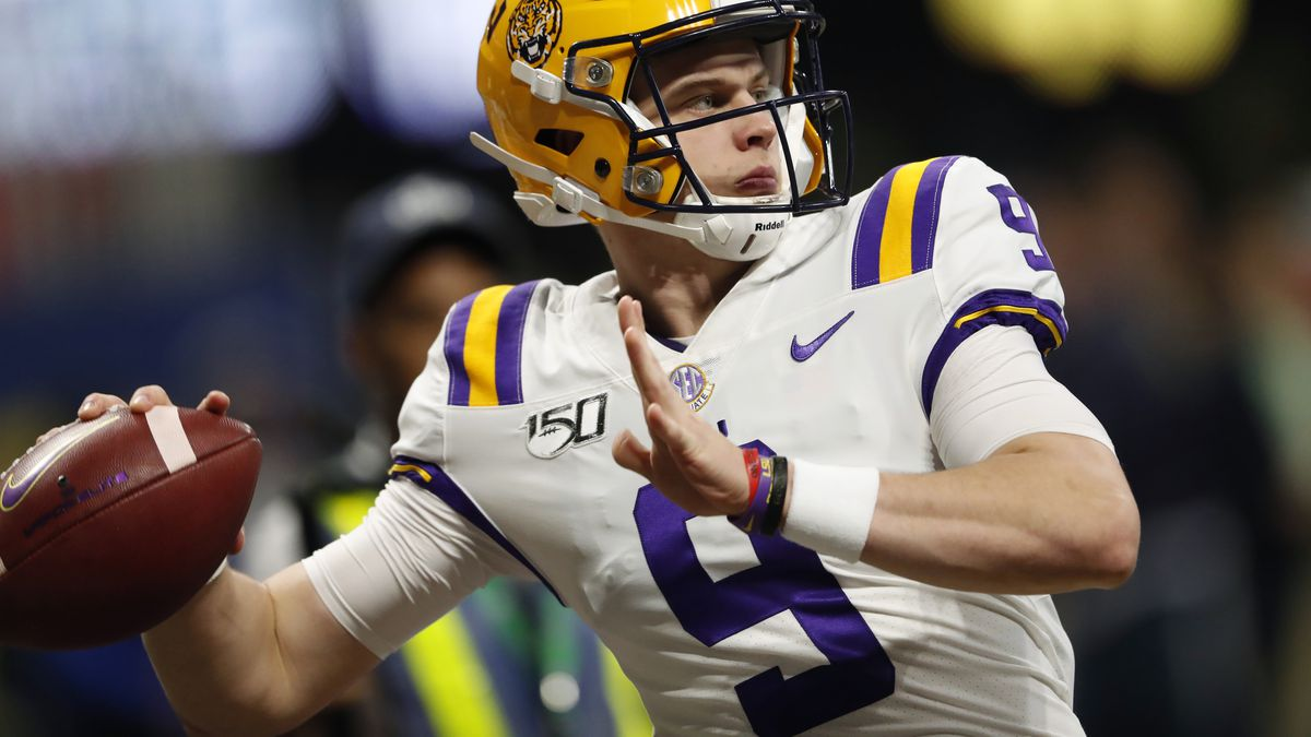 FILE - In this Dec. 7, 2019, file photo, LSU quarterback Joe Burrow (9) warms up before the Southeastern Conference championship NCAA college football game against Georgia, in Atlanta. Burrow is a unanimous selection as the offensive player of the year on The Associated Press All-Southeastern Conference football team, Monday, Dec. 9, 2019.(AP Photo/John Bazemore, File)