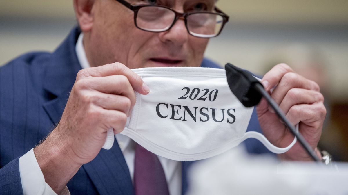 "Census Bureau Director Steven Dillingham holds up his mask with the words ""2020 Census"" as he testifies before a House Committee on Oversight and Reform hearing on the 2020 Census​ on Capitol Hill, Wednesday, July 29, 2020, in Washington."